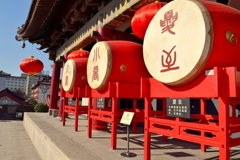 3 large red drums on top of the Xian drum tower