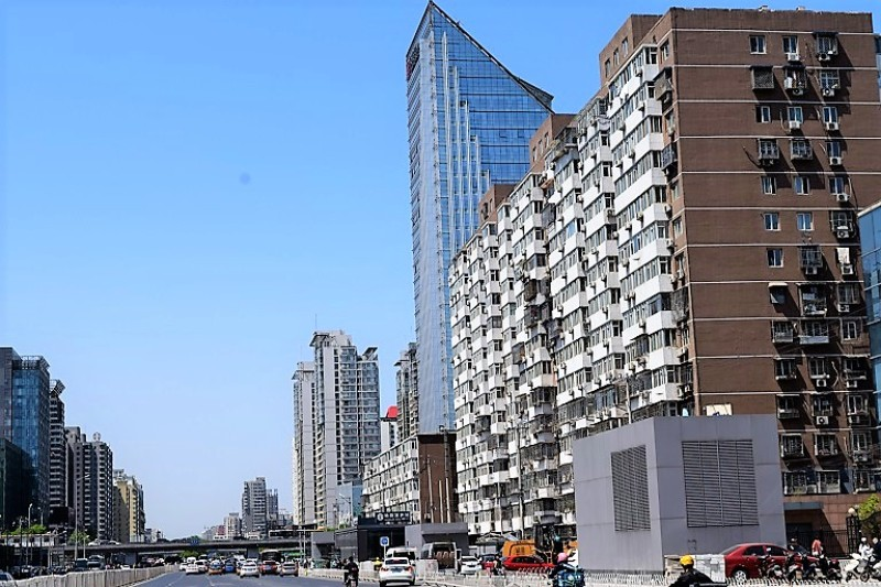 High rise apartment buildings in China against blue sky