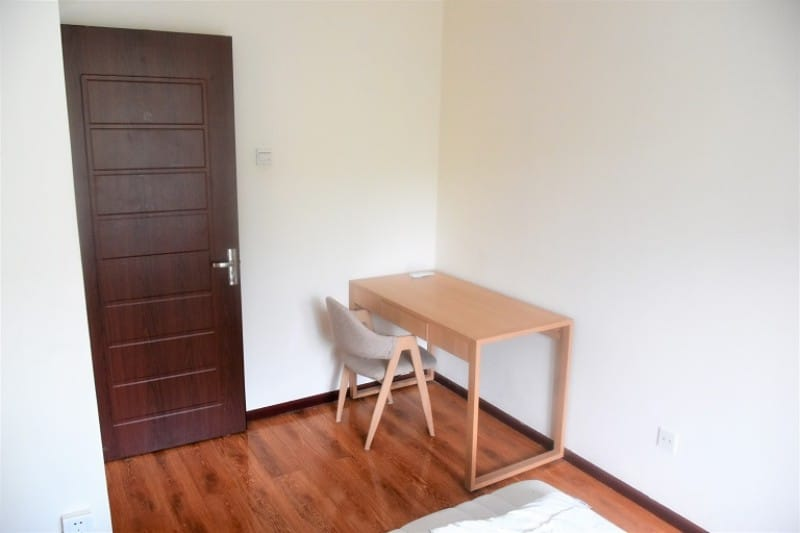 Wooden desk and chair in bedroom