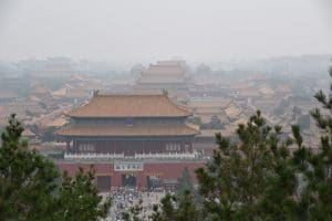A view of the forbidden city from a hill covered in pollution