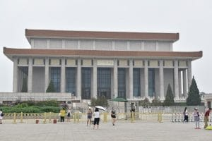 A government style building with pillars surrounding it
