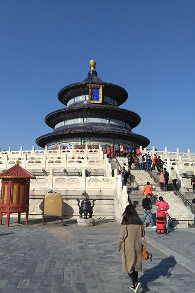 A large circular temple with blue skies