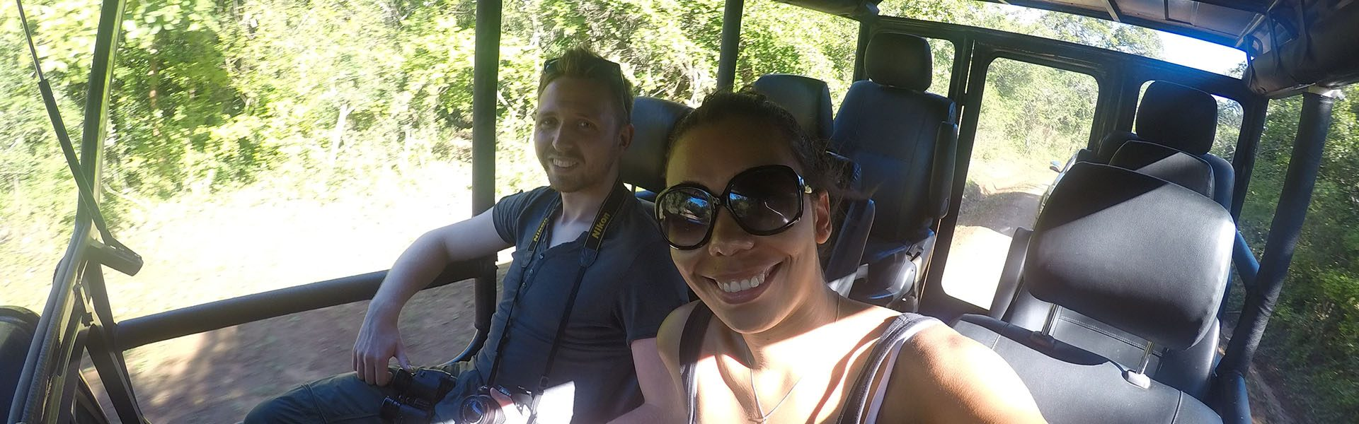 2 people on a jeep whilst travelling through Yala National Park