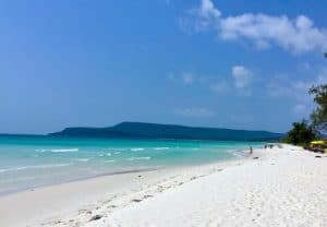 Peaceful beach with white sand and bluey-green waters