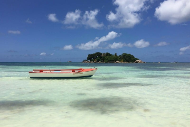 Visit Seychelles in February - Low boat on clear blue waters