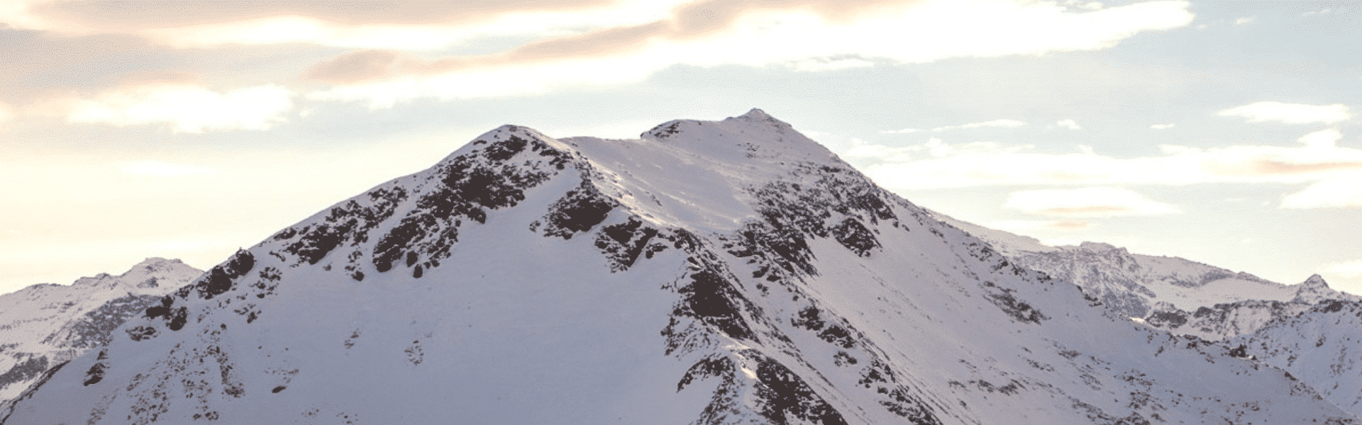 Snowy mountains with pink clouds