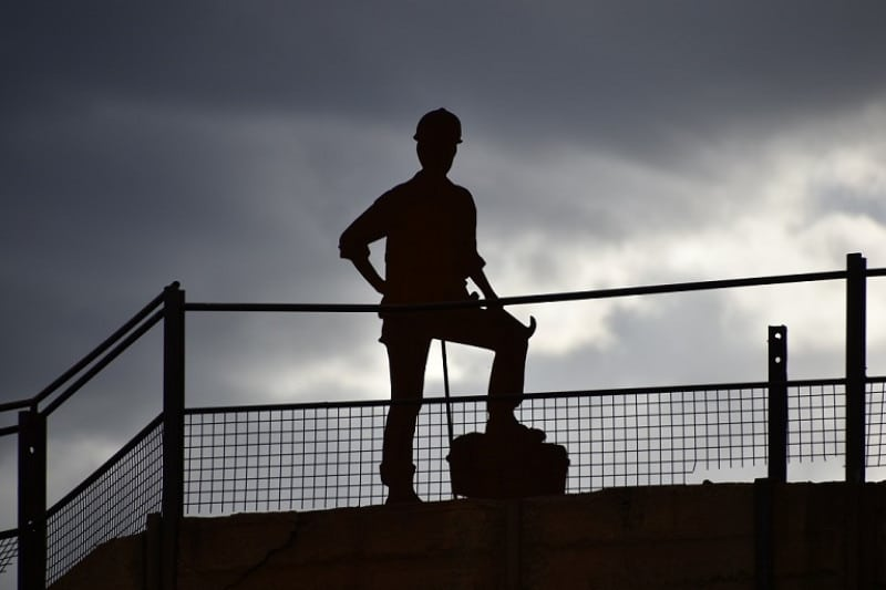 A statue of a miner in an outback town australia