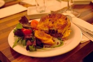 Steak and ale pie served with salad