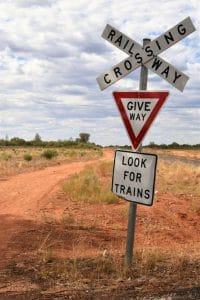 A give way sign at a train crossing cobar