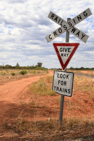 A give way sign at a train crossing cobar