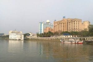 City with a few tall buildings and water in the forefront
