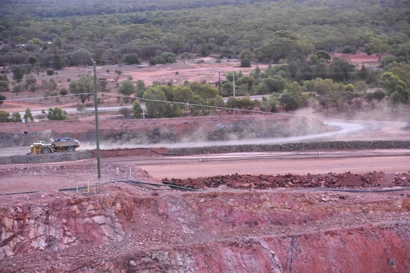 A mining lorry zooming around cobar