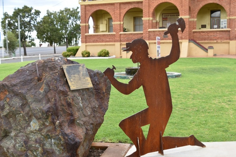 A flat metal cutout of an old miner in cobar