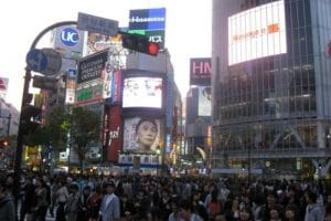 Shibuya crossing with screens and lots of people