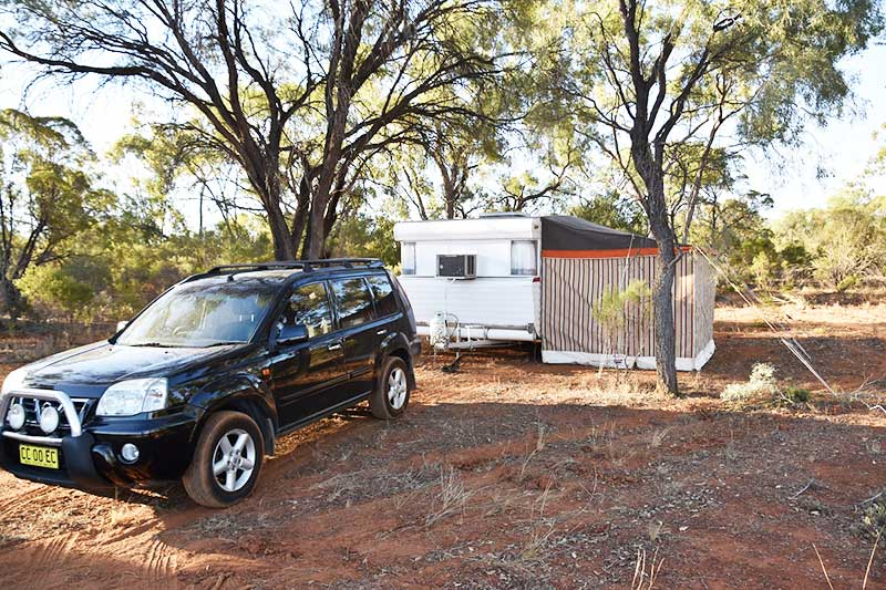 A car and caravan in the outback in Australia, is travelling a hobby?