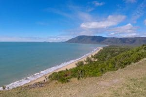 The view of a beach from a cliff on the great barrier reef drive from cairns to port douglas