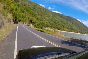 A bending highway near a beach from cairns to port douglas
