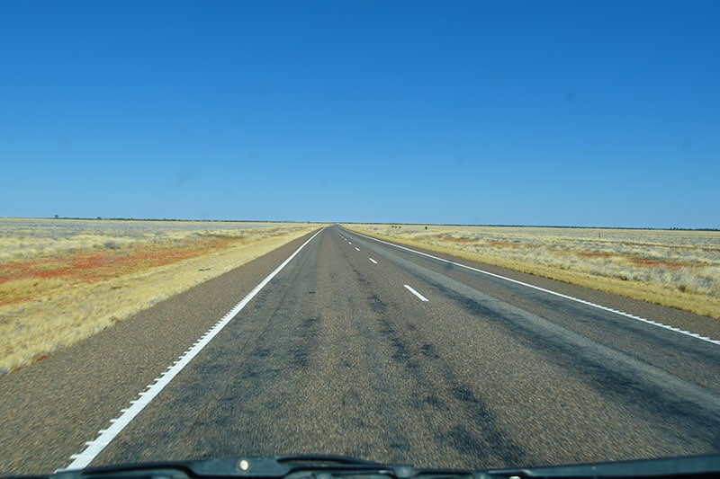 The view of a road going into the horizon whilst backpacking Australia