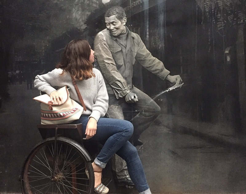 A lady sat in an interactive piece of wall art in Chengdu China