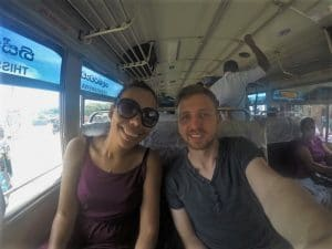 A girl and a boy staking a selfie on a bus