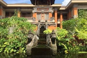 A beautiful building with pond and a lot of greenery in Bali