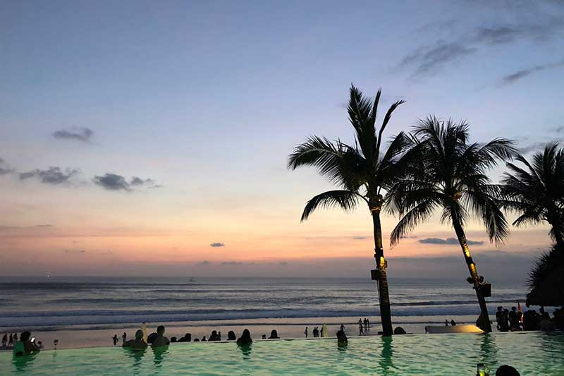 An infinity pool looking out into the Balinese Ocean
