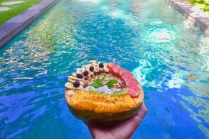 A smoothie bowl by a pool, pictured whilst backpacking in bali