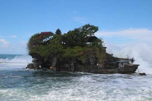 Tanah Lot temple being hit hard with waves in Bali