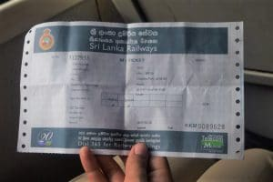 Large blue and white paper train ticket with details about the train the price