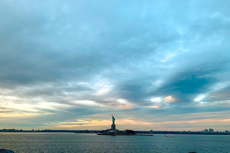 Far away view of the Statue of Liberty from water