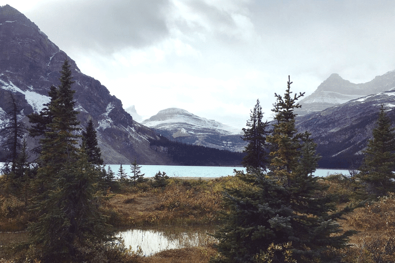 Cloudy day in the mountains with milky blue lake in Banff in September
