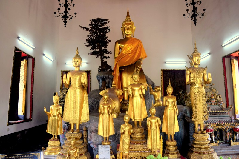 A group of golden Buddah statues in Thailand, pictured whilst backpacking around Thailand