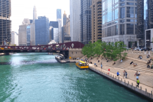 City of Chicago in September with red bridge over the water and skyscrapers in the background