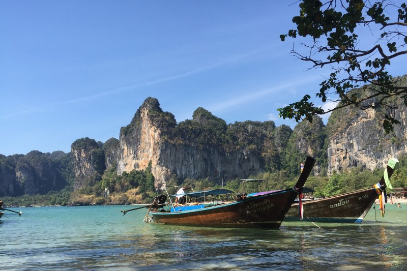 Boats and the sea on a beach in Thailand, pictured whilst backpacking around Thailand