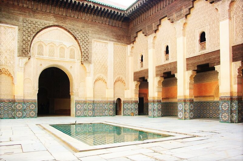Inside a riad with green pool
