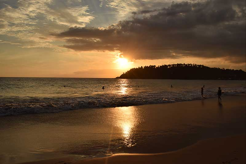 The sun setting into the mirissa beach bay, one of the best things to do in Mirissa