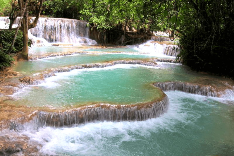 Bright greeny blue waterfall pools in Laos