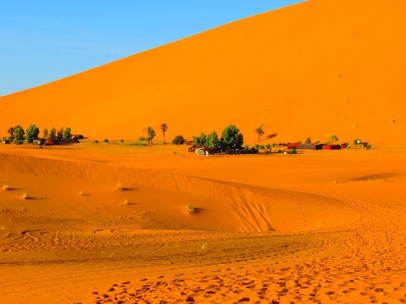 Blue sky with huge orange sand dunes
