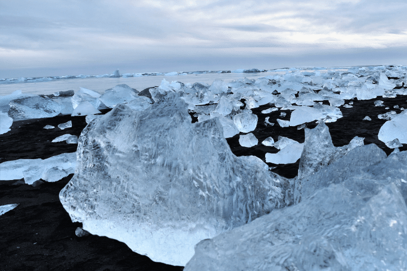 Large blocks of ice on a black sand beach