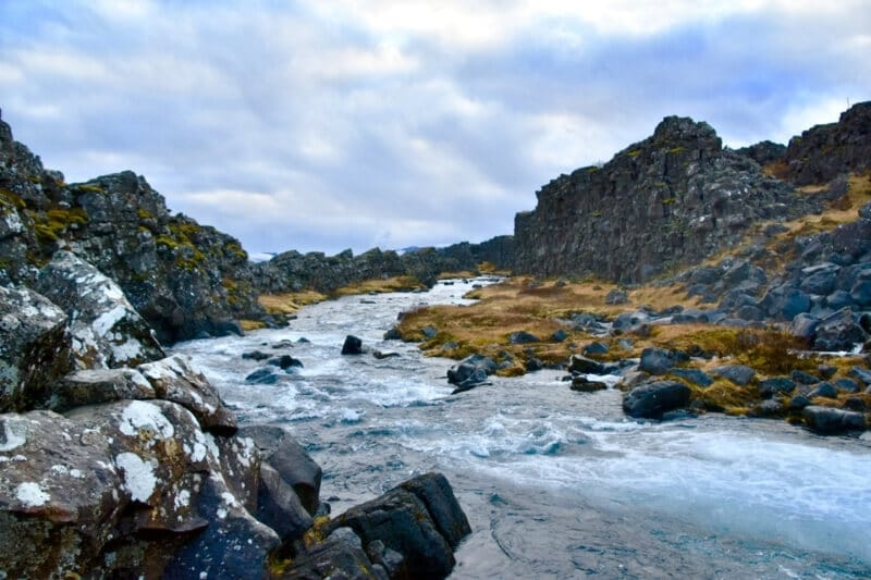 Stream flowing through the valleys in Thingvellir National Park in Iceland in November