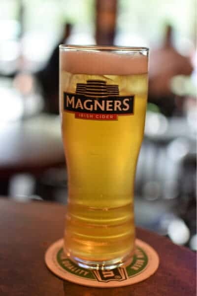 A Magners cider in branded glass
