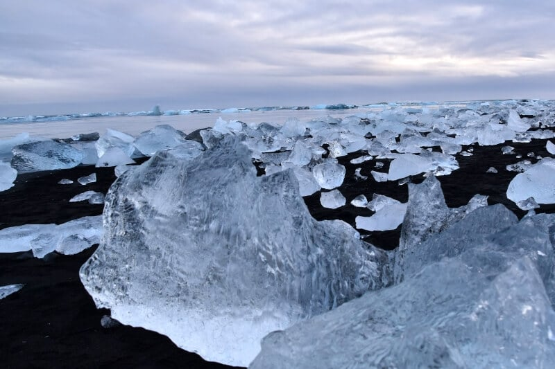 Many blocks of glacier ice washed up on diamond beach iceland