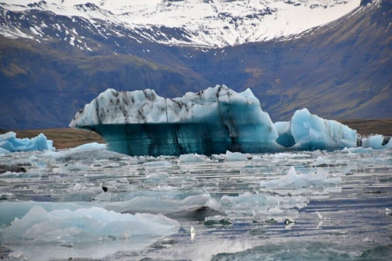 A large iceberg floating in the lagoon near diamond beach iceland