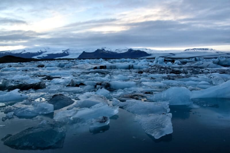 Many smaller blocks of ice floating in Jökulsárlón lagoon near diamond beach iceland