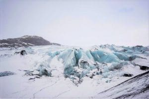 blue and white ice in a glacier
