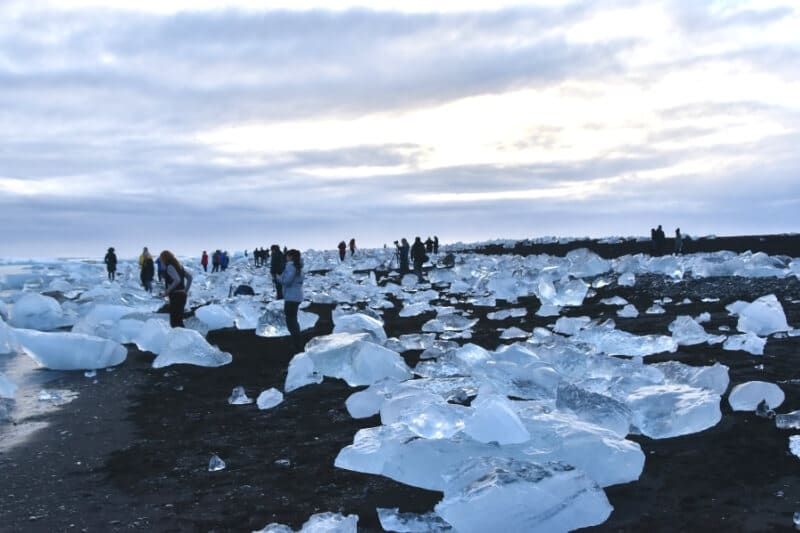 People gathering together on diamond beach iceland