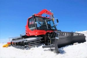 Red snowcat machine on snow