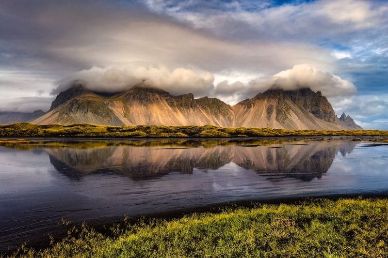A mountain reflecting into the sea on one of iceland beaches