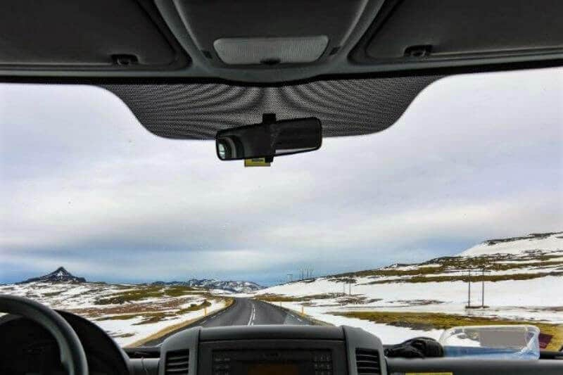 view from inside of a car from windscreen looking out at empty road