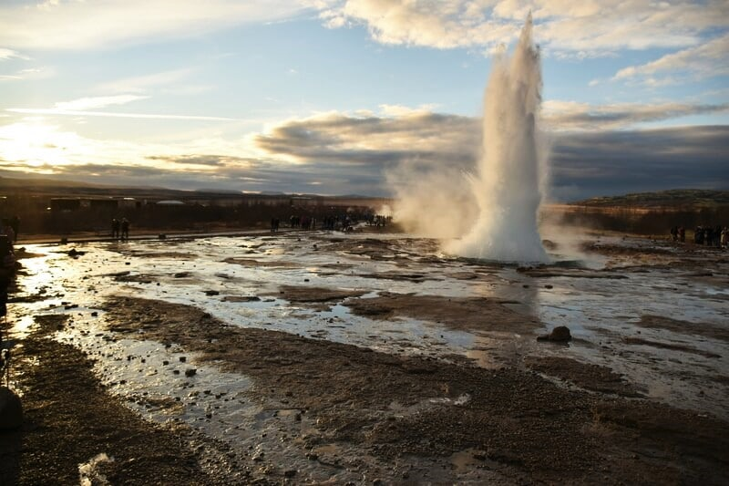 large geyser erupting with huge spout of water